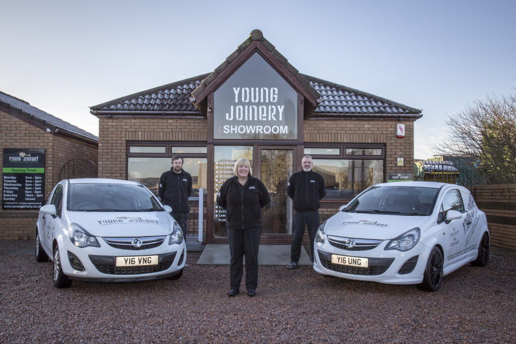 Young Joinery showroom staff and vehicles at entrance