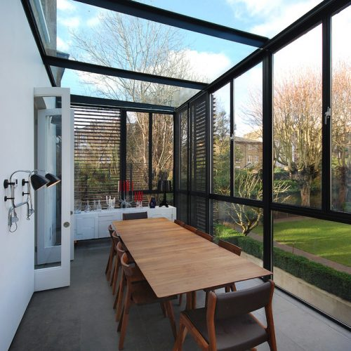 Glass sunroom with dining table