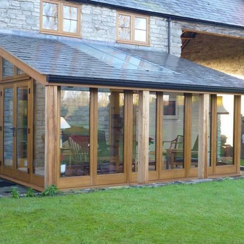 Modern wood extension with glass