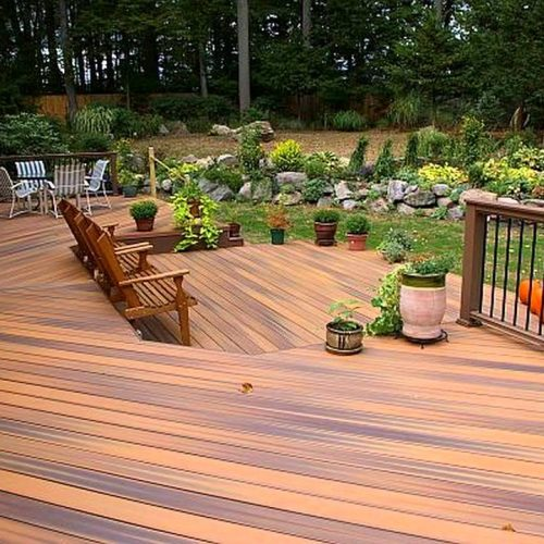 New decking in garden with benches