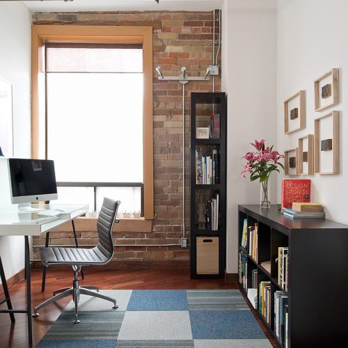Home office with brick and window